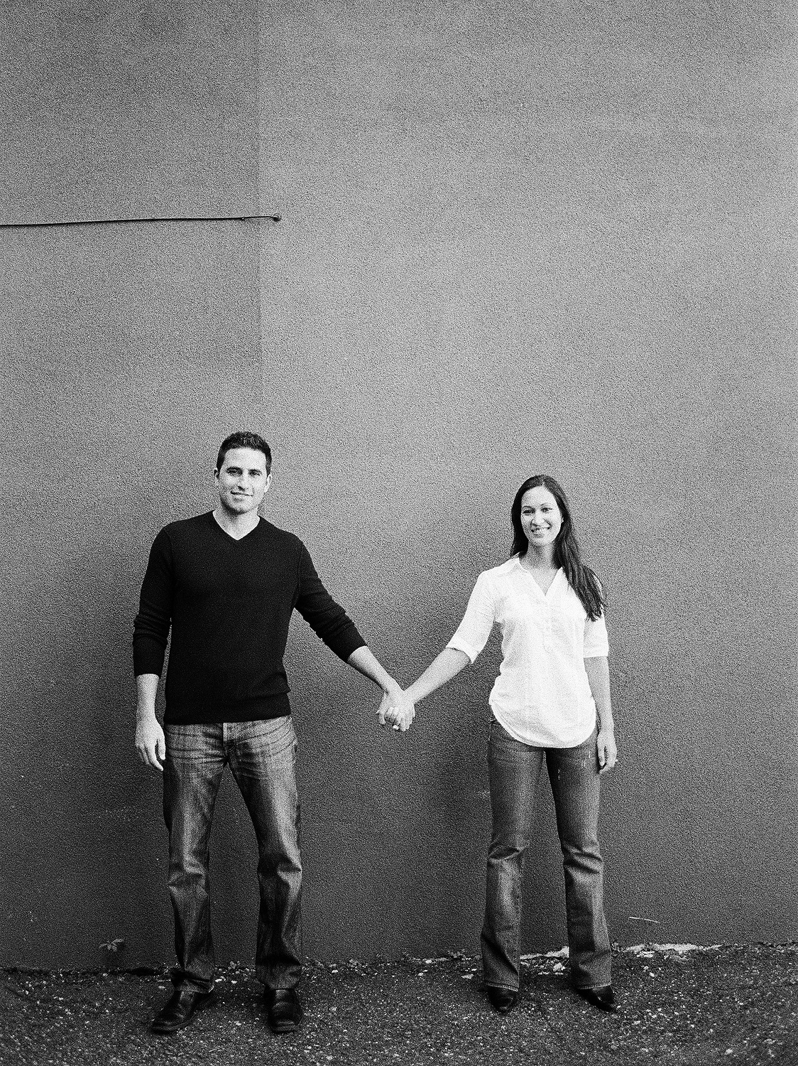 BNW engagement portrait outfit ideas of couple holding hands in hoboken new jersey by wendy g photography