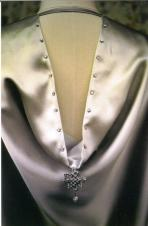 The false hood is embellished with the same crystals as the dress.