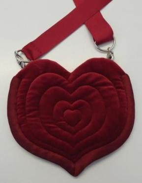 Dance bag with quilted concentric hearts