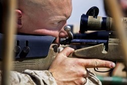 man using tactical scope