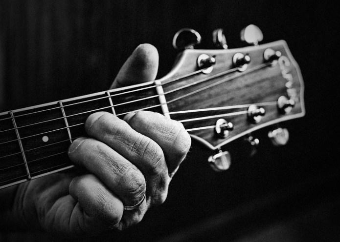 holding guitar