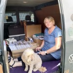 Kath sorting out patterns for the Shows in the back of the van
