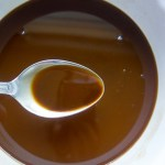 how to make a roux: a step-by-step guide, dark brown roux in a bowl with spoon
