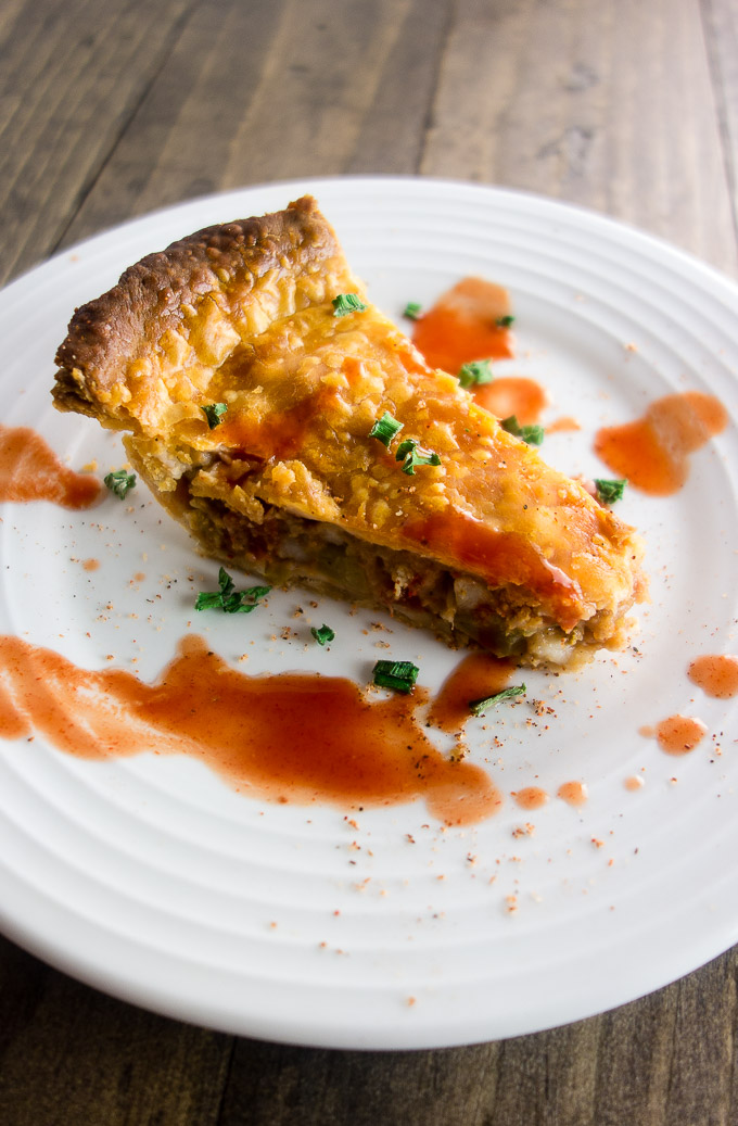 easy homemade crawfish pie, pieve of pie on a plate, crawfish tail meat, cajun roux