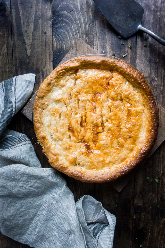 easy homemade crawfish pie in a pie plate made with roux and crawfish tail meat