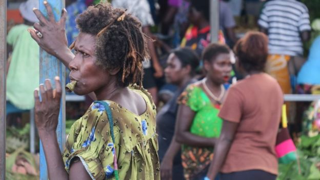Woman chewing betel nut on a market in Bougainville