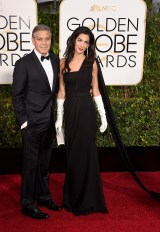 Goerge and Amal Clooney attends the 72nd annual Golden Globe Awards