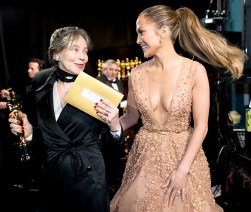 After presenting the Oscar for Best Costume Design (and nearly tripping!), Jennifer Lopez laughed off the incident with winner Milena Canonero