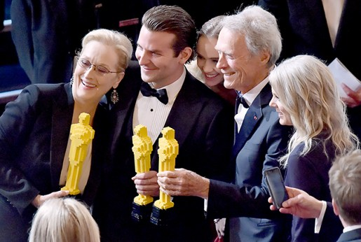 Losing Oscar nominees Meryl Streep, Bradley Cooper, and Clint Eastwood held up their Lego statues onstage during the 87th Academy Awards.