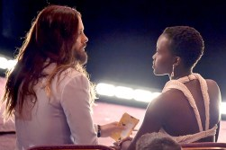 Lupita Nyong'o enjoyed a quiet moment with her fellow 2014 Supporting Actor Oscar winner Jared Leto in the front row