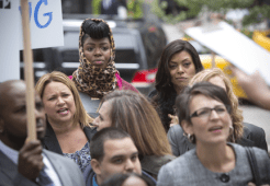 """EMPIRE: Porsha (guest star Ta' Rhonda Jones, L) and Cookie (Taraji P. Henson, R) watch a protest in the """"Outspoken King"""" episode of EMPIRE airing Monday, Jan. 14 (9:00-10:00 PM ET/PT) on FOX. ©2014 Fox Broadcasting Co. CR: Chuck Hodes/FOX"""
