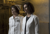 """GOTHAM: Dr. Leslie Thompkins (guest star Morena Baccarin, R) and Nurse Dorothy Duncan (guest star Allyce Beasley, L) try to help James Gordon solve a case in the """"Rogues' Gallery"""" episode of GOTHAM airing Monday, Jan. 5 (8:00-9:00 PM ET/PT) on FOX. ©2014 Fox Broadcasting Co. Cr: Jessica Miglio/FOX"""