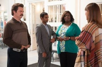 """PARKS AND RECREATION -- """"William Henry Harrison"""" Episode 705 -- Pictured: (l-r) Nick Offerman as Ron Swanson, Aziz Ansari as Tom Haverford, Retta as Donna Meagle, Erinn Hayes as Annabel -- (Photo by: Colleen Hayes/NBC)"""