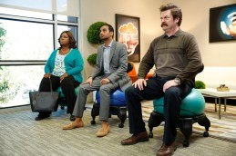 """PARKS AND RECREATION -- """"GryzzlBox"""" Episode 706 -- Pictured: (l-r) Retta as Donna Meagle, Aziz Ansari as Tom Haverford, Nick Offerman as Ron Swanson -- (Photo by: Greg Gayne/NBC)"""