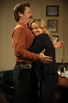 "PARKS AND RECREATION -- ""Save JJ's"" Episode 707 -- Pictured: (l-r) Nick Offerman as Ron Swanson, Amy Poehler as Leslie Knope -- (Photo by: Colleen Hayes/NBC)"