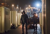 """Arrow -- """"Canaries"""" -- Image AR313B_0033b -- Pictured (L-R): Stephen Amell as Oliver Queen / The Arrow and Colton Haynes as Roy Harper / Arsenal -- Photo: Diyah Pera/The CW -- �© 2015 The CW Network, LLC. All Rights Reserved."""