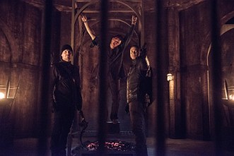 """Arrow -- """"Nanda Parbat"""" -- Image AR315B_0308b -- Pictured (L-R): Stephen Amell as Oliver Queen, John Barrowman as Malcolm Merlyn, and David Ramsey as John Diggle -- Photo: Cate Cameron/The CW -- © 2015 The CW Network, LLC. All Rights Reserved."""