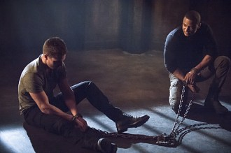 """Arrow -- """"Nanda Parbat"""" -- Image AR315B_0212b -- Pictured (L-R): Stephen Amell as Oliver Queen and David Ramsey as John Diggle -- Photo: Cate Cameron/The CW -- © 2015 The CW Network, LLC. All Rights Reserved."""