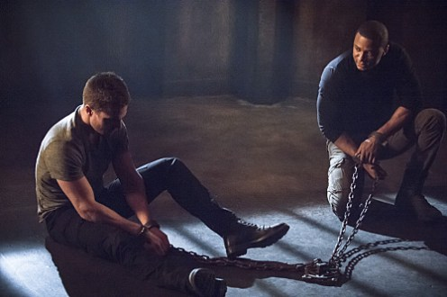 "Arrow -- ""Nanda Parbat"" -- Image AR315B_0212b -- Pictured (L-R): Stephen Amell as Oliver Queen and David Ramsey as John Diggle -- Photo: Cate Cameron/The CW -- © 2015 The CW Network, LLC. All Rights Reserved."