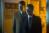 "GOTHAM: Gordon (Ben McKenzie, R) and Dent (guest star Nicholas D'Agosto, L) investigate a lead in the ""Everyone Has A Cobblepot"" episode of GOTHAM airing Monday, March 2 (8:00-9:00 PM ET/PT) on FOX. ©2015 Fox Broadcasting Co. Cr: Jessica Miglio/FOX"