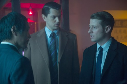"""GOTHAM: Gordon (Ben McKenzie, R) and Dent (guest star Nicholas D'Agosto, C) interview a suspect (guest star Perry Yung, L) in the """"Everyone Has A Cobblepot"""" episode of GOTHAM airing Monday, March 2 (8:00-9:00 PM ET/PT) on FOX. ©2015 Fox Broadcasting Co. Cr: Jessica Miglio/FOX"""