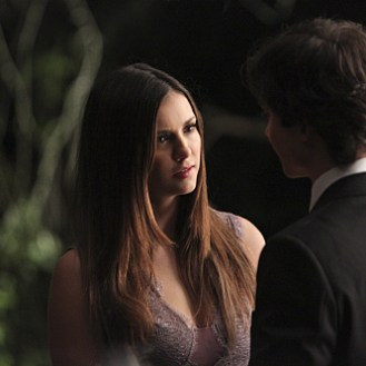 "The Vampire Diaries -- ""I'm Thinking of You All The While"" -- Image Number: VD622c_0264.jpg -- Pictured (L-R): Nina Dobrev as Elena and Ian Somerhalder as Damon (back to camera) -- Photo: Annette Brown/The CW -- �© 2015 The CW Network, LLC. All rights reserved."