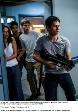 MAZE RUNNER: THE SCORCH TRIALS Thomas (Dylan O'Brien, right) leads Teresa (Kaya Scodelario), Minho (Ki Hong Lee), and Newt (Thomas Brodie-Sangster) in a daring escape from WCKD. Photo credit: Richard Foreman, Jr. SMPSP TM and © 2015 Twentieth Century Fox Film Corporation.  All Rights Reserved.  Not for sale or duplication.