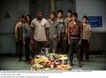MAZE RUNNER: THE SCORCH TRIALS The surviving Gladers react to something they hadn't seen a long time: a feast…courtesy of WCKD. (left to right) Glader (Gary Hood), Teresa (Kaya Scodelario), Frypan (Dexter Darden), Thomas (Dylan O'Brien), Minho (Ki Hong Lee), Newt (Thomas Brodie-Sangster), Winston (Alexander Flores) and Jack (Bryce Romero). Photo credit: Richard Foreman, Jr. SMPSP TM and © 2015 Twentieth Century Fox Film Corporation.  All Rights Reserved.  Not for sale or duplication.