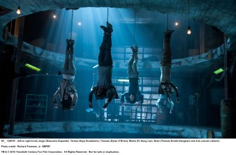MAZE RUNNER: THE SCORCH TRIALS (left to right front) Jorge (Giancarlo Esposito), Teresa (Kaya Scodelario), Thomas (Dylan O'Brien), Minho (Ki Hong Lee), Newt (Thomas Brodie-Sangster) and Aris (Jacob Lofland). Photo credit: Richard Foreman, Jr. SMPSP TM and © 2015 Twentieth Century Fox Film Corporation.  All Rights Reserved.  Not for sale or duplication.