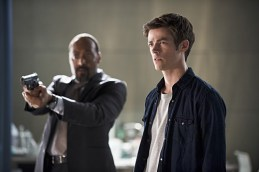 """The Flash -- """"The Man Who Saved Central City"""" -- Image FLA201b_0429b.jpg -- Pictured (L-R): Jesse L. Martin as Detective Joe West and Grant Gustin as Barry Allen -- Photo: Cate Cameron /The CW -- © 2015 The CW Network, LLC. All rights reserved."""