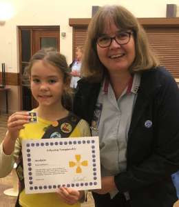 Girlguiding Nottinghamshire's County Commissioner Jackie Brocklehurst presenting West Bridgford Brownie Clara Cuddington with her Celtic Cross.