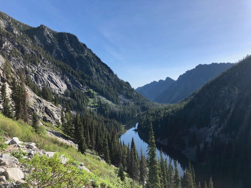 Narrow lake nestled between high mountains