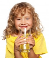 Happy child drinking water