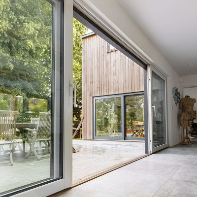 Plan ahead for next summer – bring the outside in with composite aluminium timber sliding doors or bi-fold doors