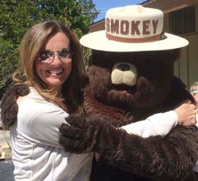 west creek media's anita gnan with smokey the bear