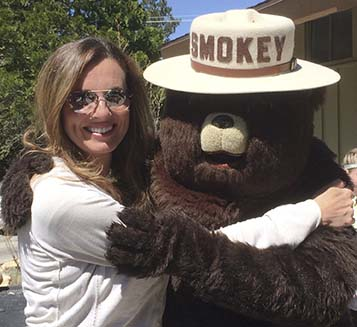 author anita gnan with smokey the bear