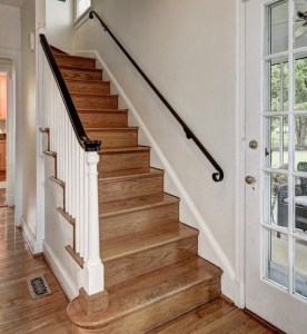 Kids used to run down that staircase , grab the bannister, and swing over the last few steps, redirecting themselves toward the kitchen.