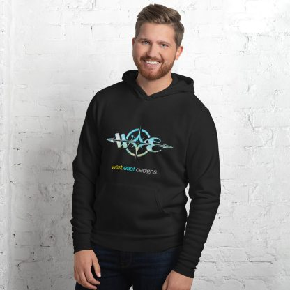 Male model wearing a size M of the West East Designs Logo Hoodie in the Swirled Compass design.