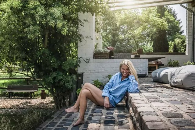 Mature woman sitting on terrace steps