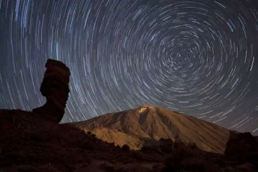 Spain, Tenerife, Star trails over Teide volcano in Teide National Park