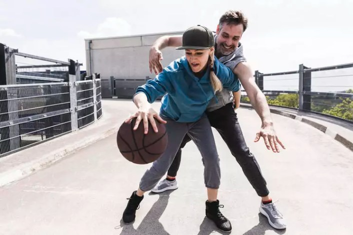 Man and woman playing basketball