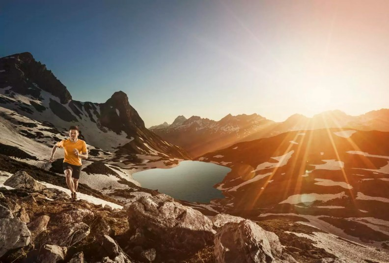 Germany, Allgaeu Alps, man running in mountains