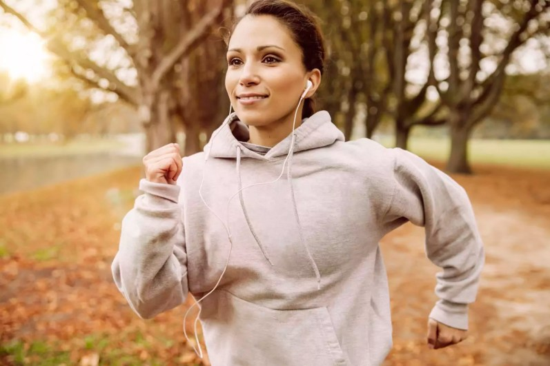 Woman jogging in park during autumn
