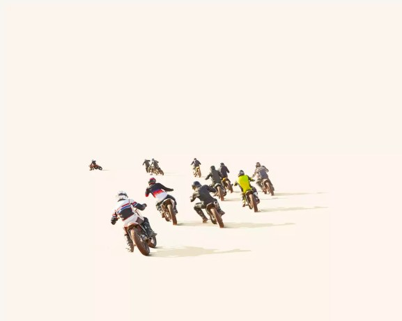 People motocross racing against white background
