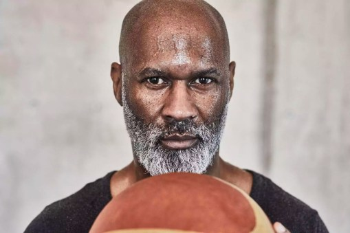 Portrait of serious mature man holding basketball