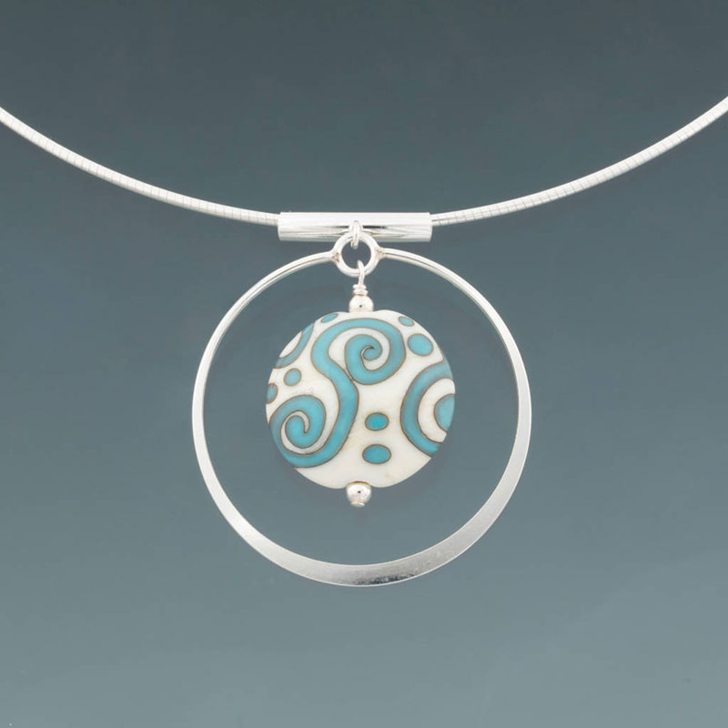 """Becky Congdon """"Aztec Dreaming Circle Omega"""" handmade flameworked glass bead with sterling silver findings/chain 18"""" $95. Inquire on availability"""