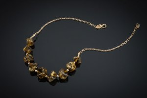 "Becky Congdon ""Maple Gold Nuggets Necklace"" 20"" handmade flamework glass and gold leaf beads with gold filled beads and chain (photo: Ann Cady) $300."