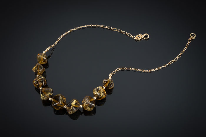 "Becky Congdon ""Maple Gold Nuggets Necklace"" 20"" handmade flameworked glass and gold leaf beads with gold filled beads and chain (photo by Ann Cady) $300. SOLD"