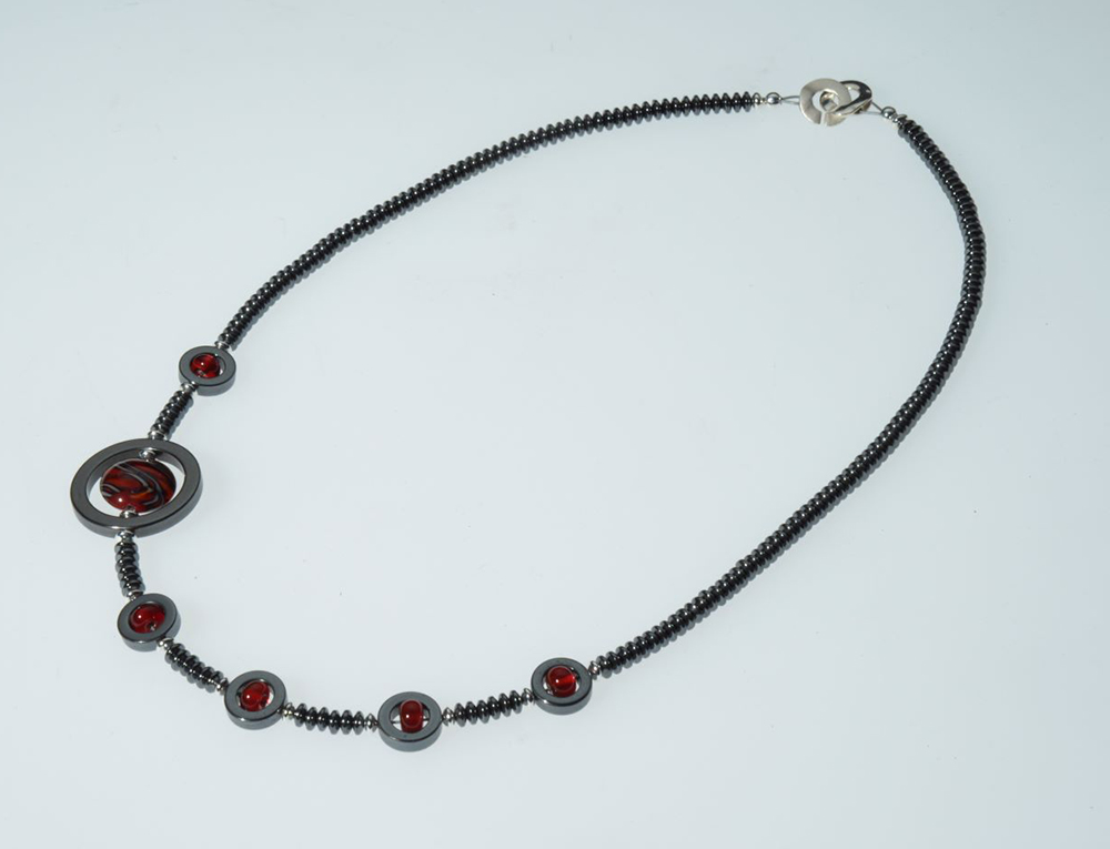 "Becky Congdon ""Off Centered Ribbon Necklace"" handmade flameworked glass beads, hematite gemstone, SS 22"" $150. SOLD"