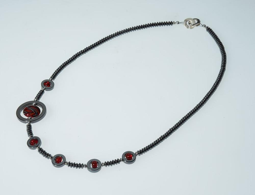 "Becky Congdon ""Off Centered Ribbon Necklace"" handmade flameworked glass beads, hematite gemstone, SS 22"" $150."